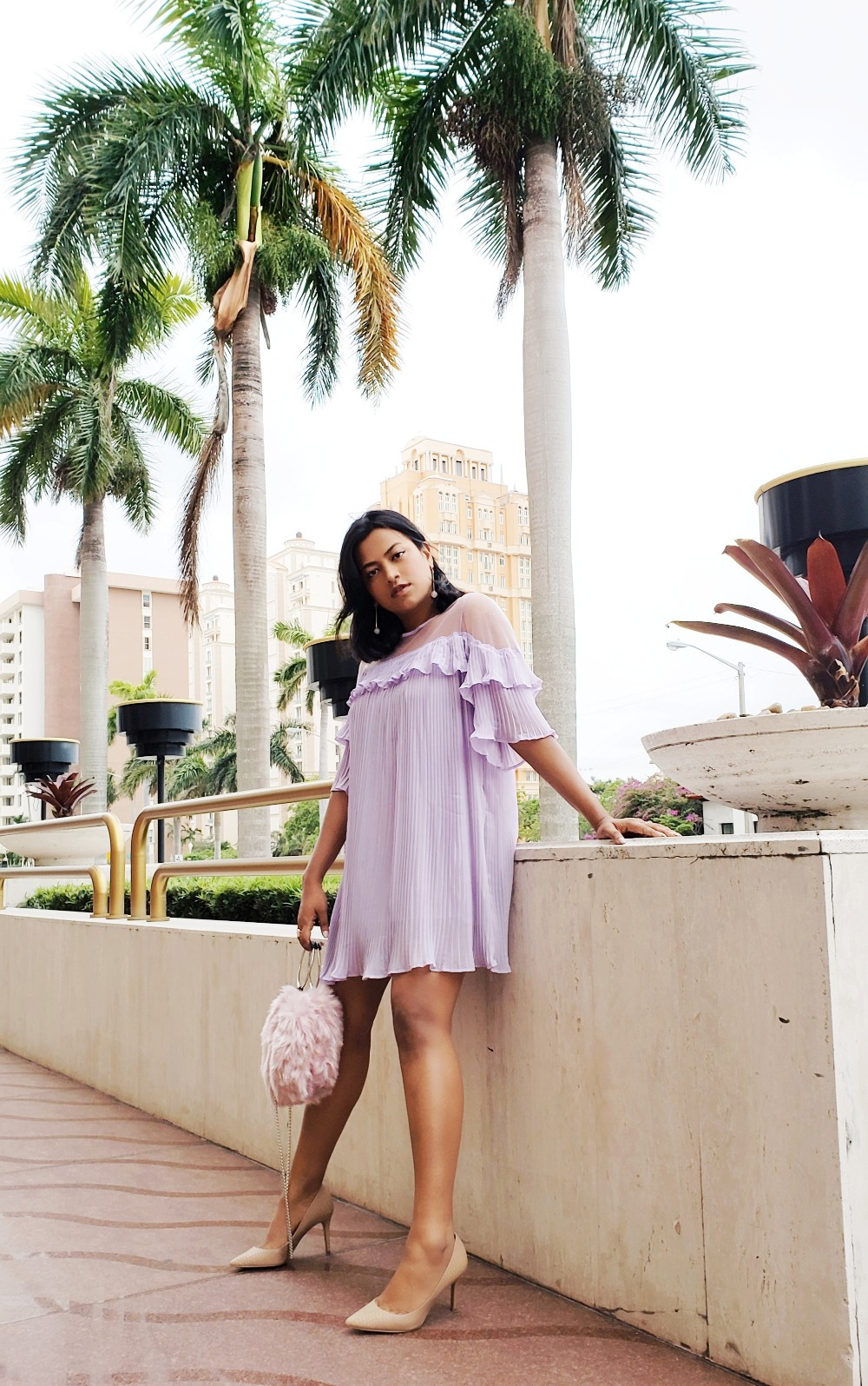 Afroza Khan wearing grown-up Pink Lavender Dress with a Pink Purse