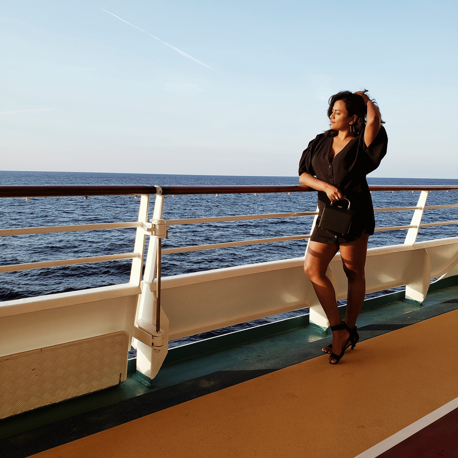 Travel Blogger Afroza Khan on the Royal Caribbean Mariner of the Seas cruise during golden hour