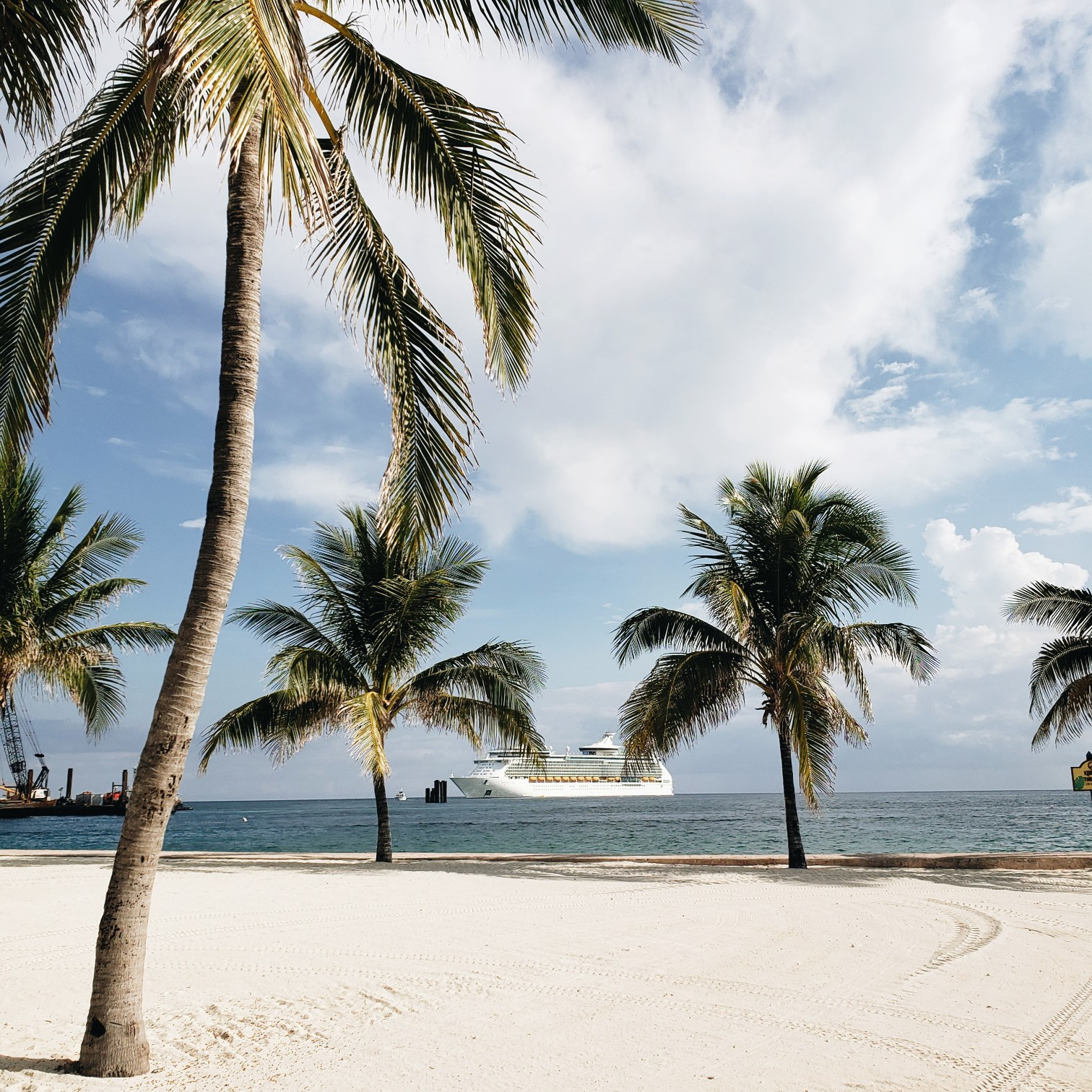 royal caribbean mariner of the seas deck next to Cococay Island Bahamas Full of Palm Trees
