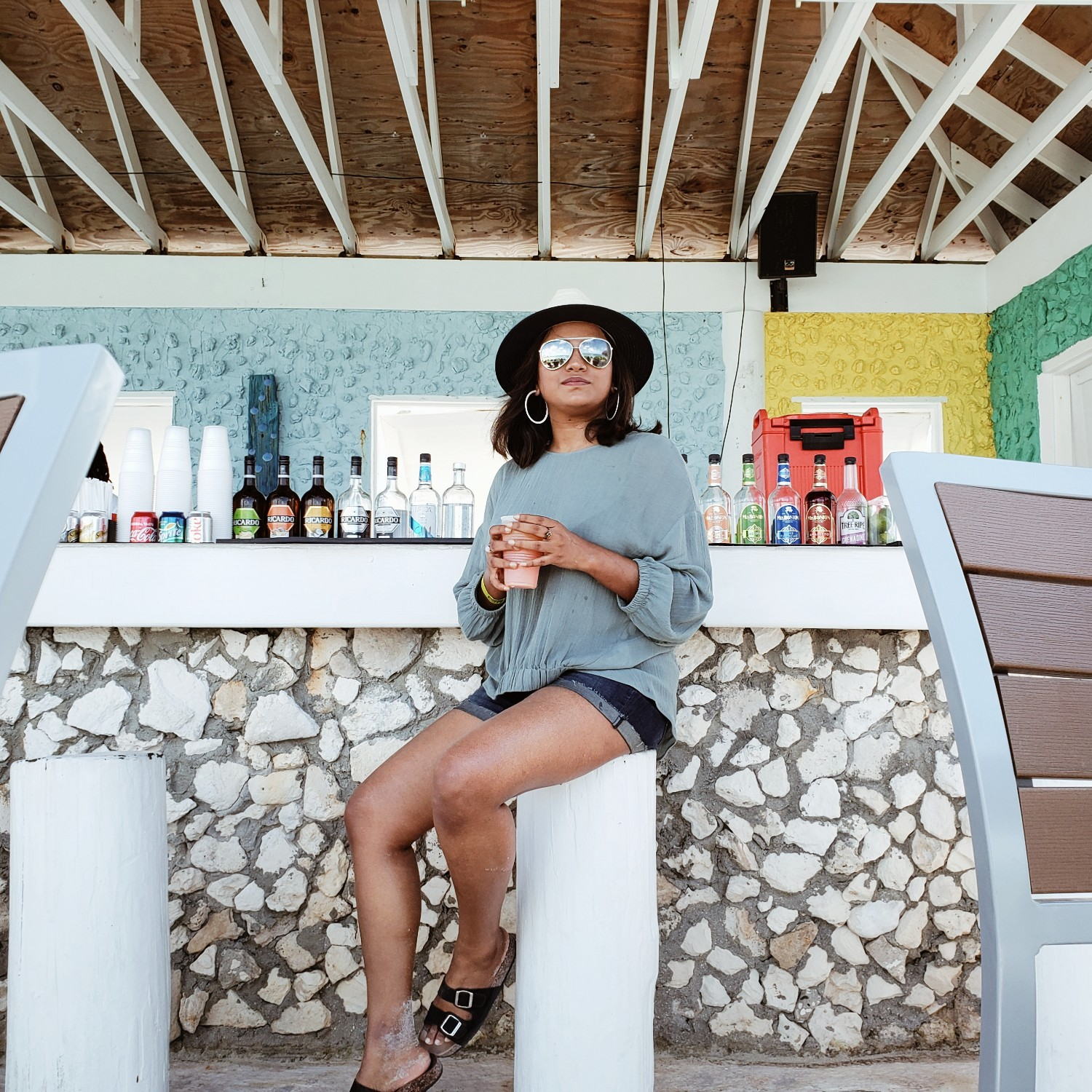 Travel Blogger Afroza Khan Drinking Cocktails