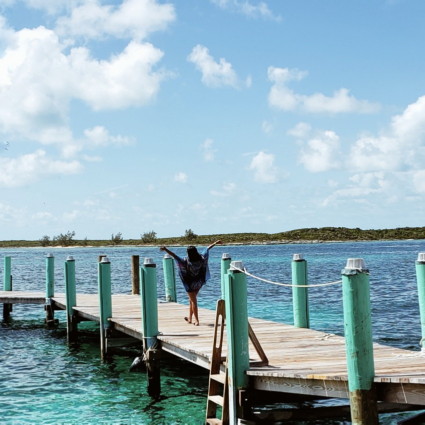 Travel Blogger in Pearl Island Bahamas Pier