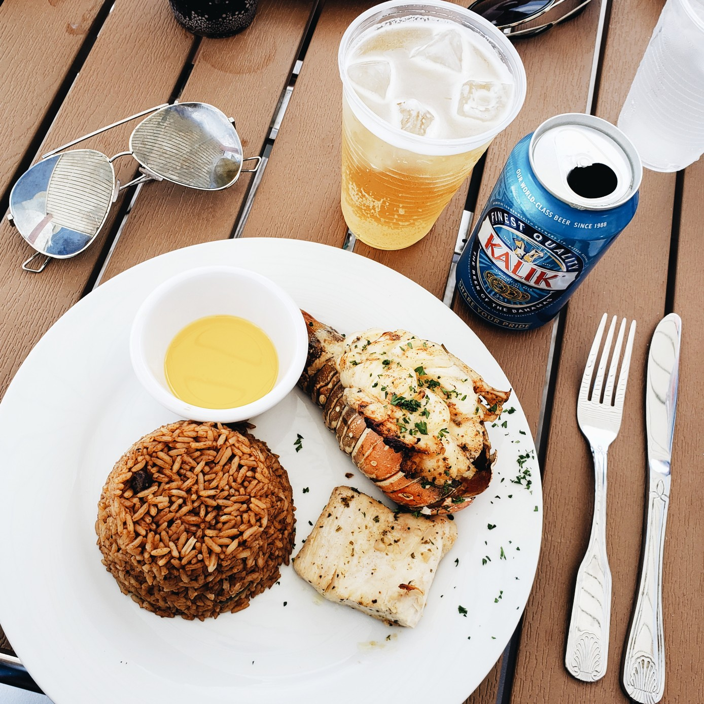 Pearl Island Nassau Bahamas Lobster Lunch with Kalik Drink
