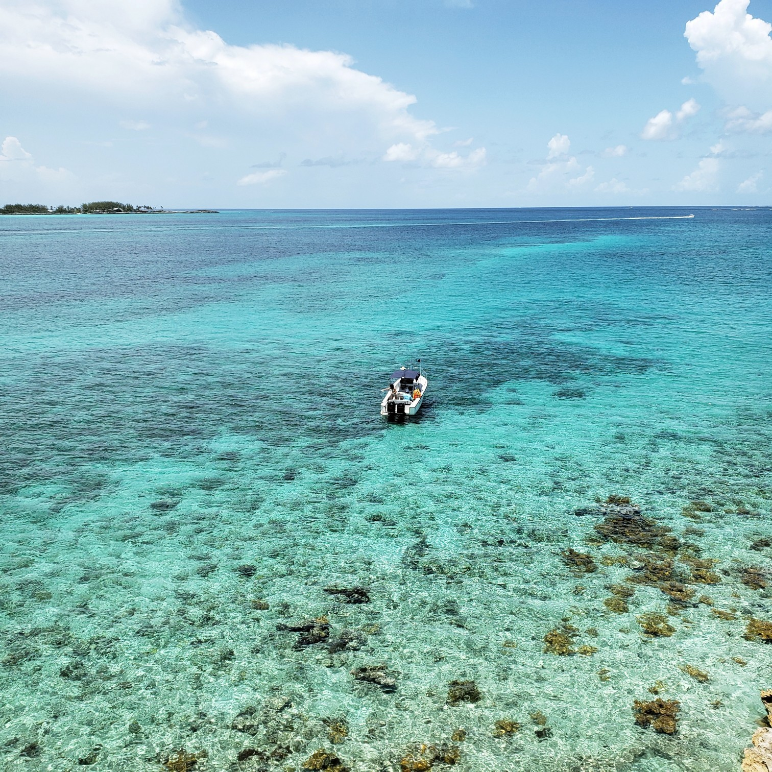 Boat on crystal clear water near Pearl Island