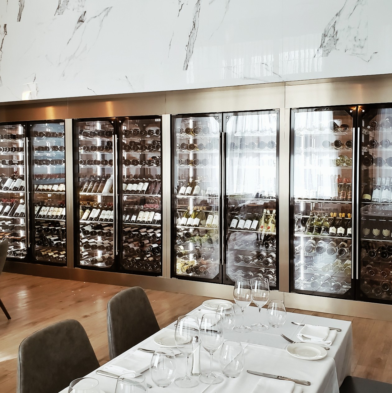 Large wine selection refrigeration inside restaurant