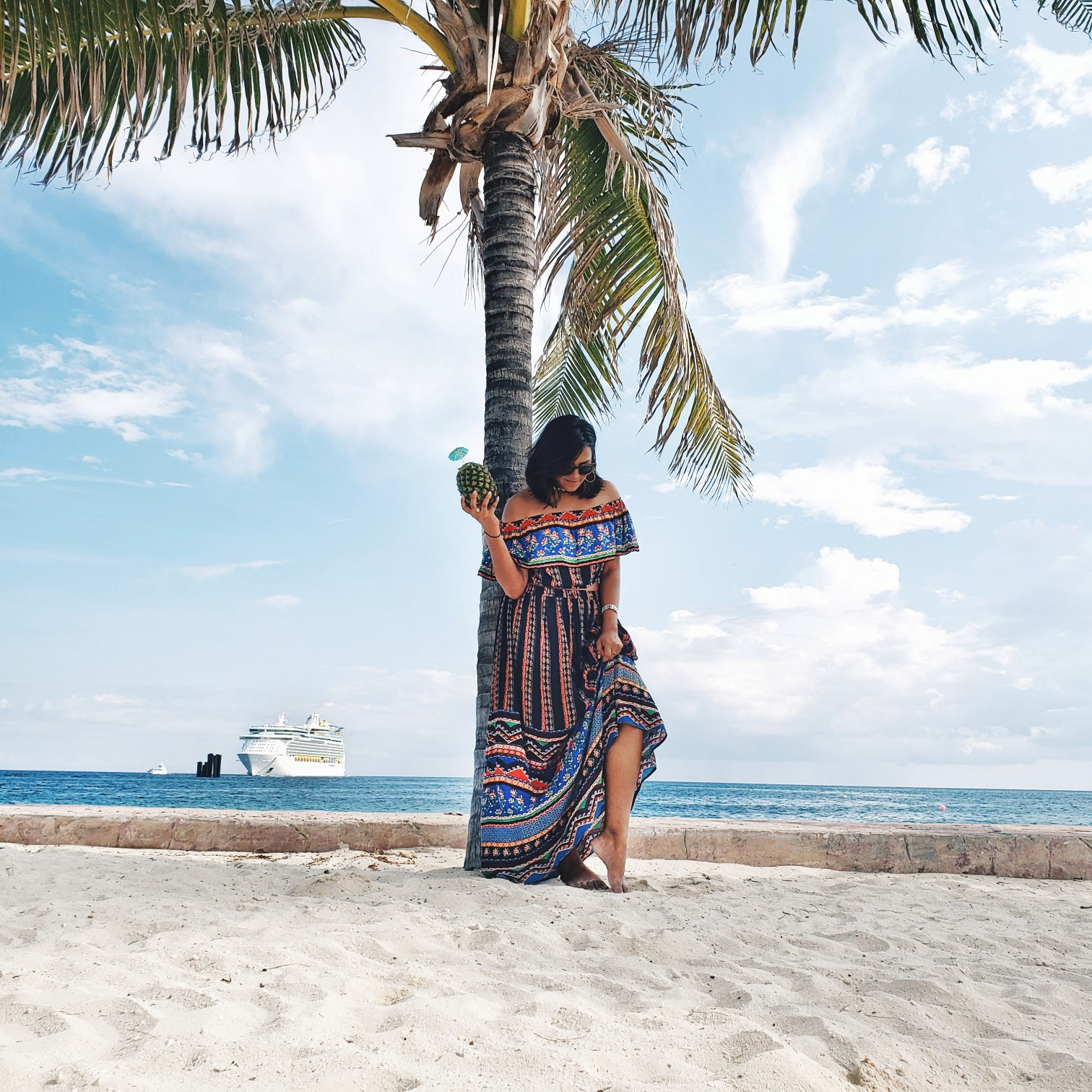 Travel Blogger Afroza Khan in Tribal print dress in CocoCay Island Bahamas