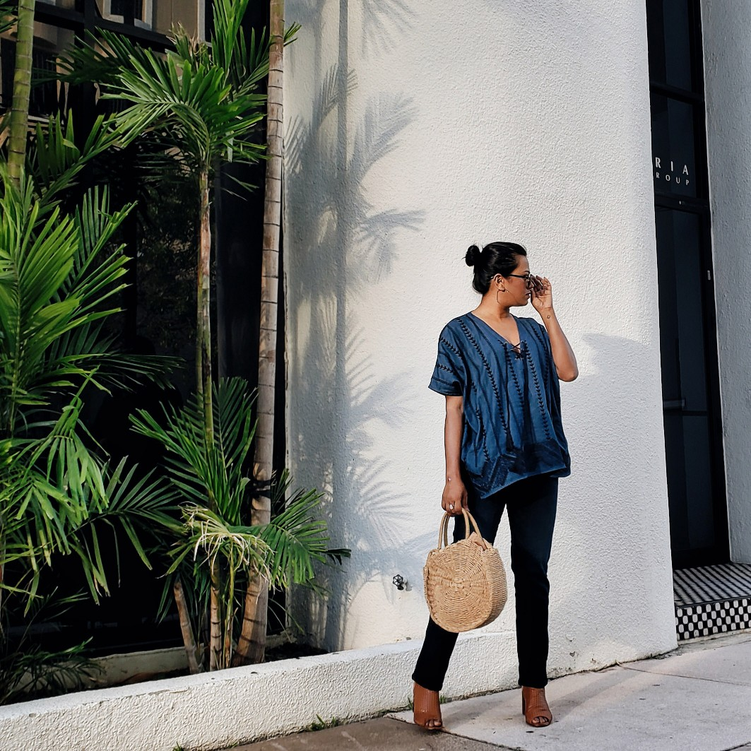 Fashion Blogger Blue Top Blue Jeans Straw Bag street style