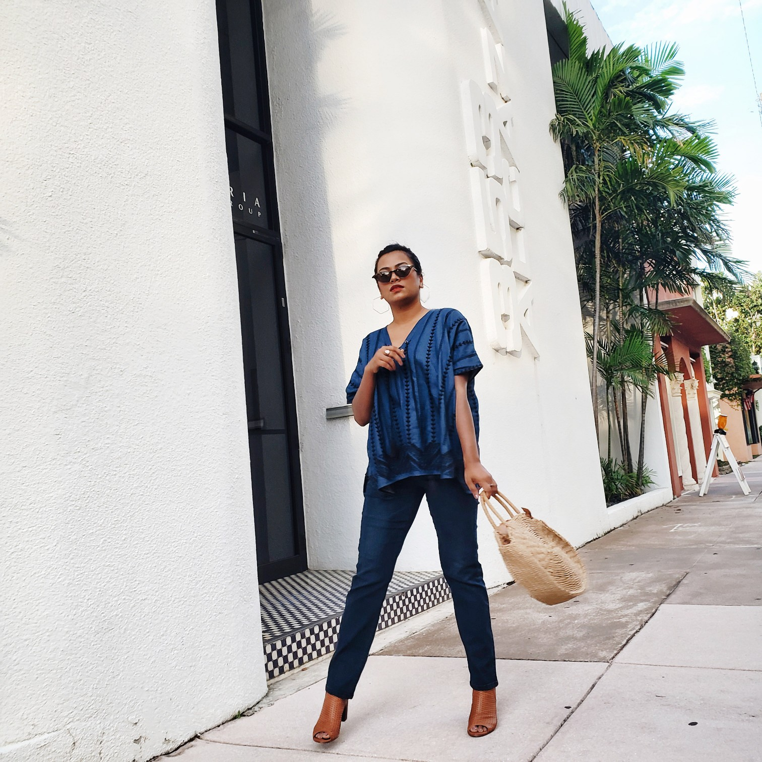 Fashion Blogger Blue Jeans & Straw Bag