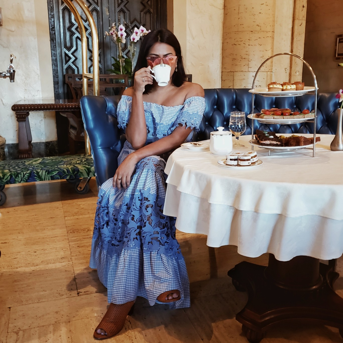 Miami Blogger wearing maxi gingham dress sipping tea at Biltmore Coral Gables