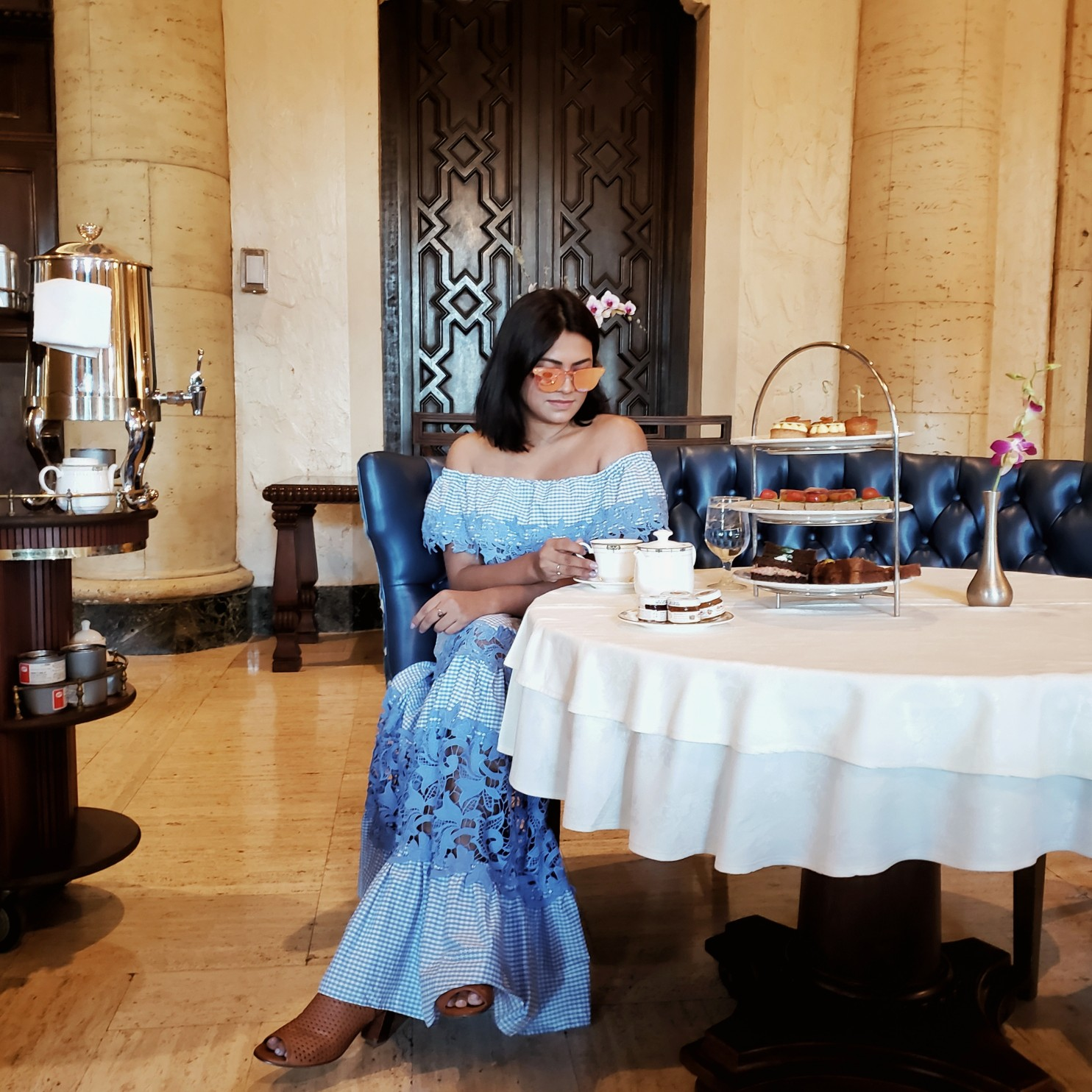 Miami Fashion blogger wearing gingham dorothy maxi dress from Venus having High tea at biltmore hotel miami Coral Gables