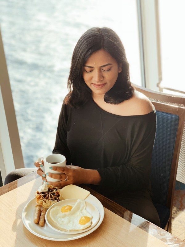 Miami Fashion Travel Lifestyle Blogger Afroza Khan eating breakfast in Royal Caribbean Symphony of the Seas windjammer cruise reviewer