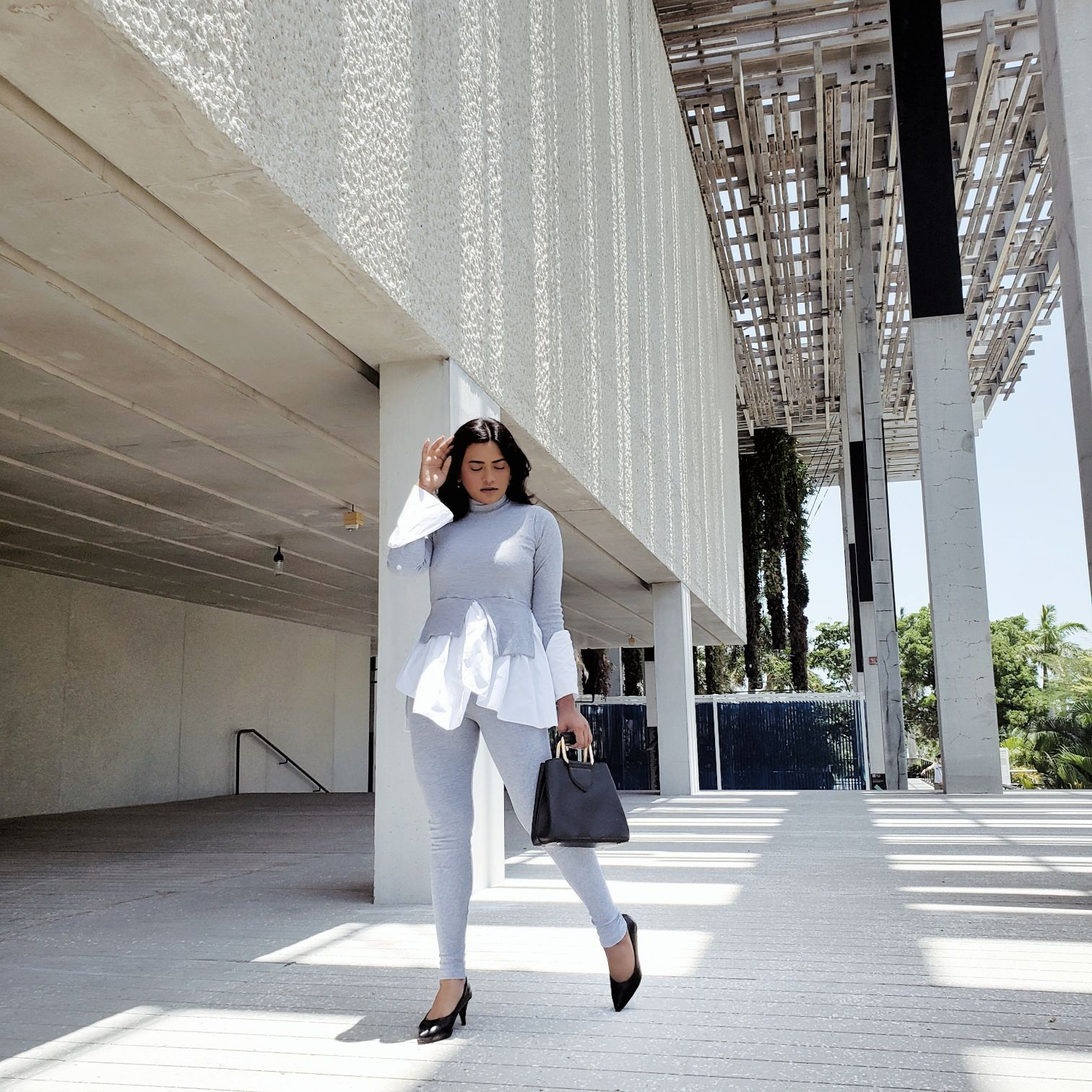 Afroza Khan wearing Grey Layered Look Jumper Shirt Loungewear Femme Luxe Finery Black Pointed Toe Heels Miami Style Blogger