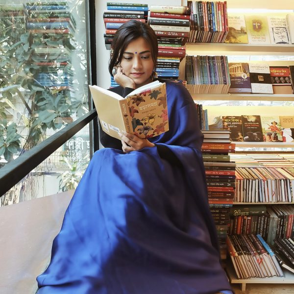 Bangladeshi Girl in Blue Saree reading Bangla book