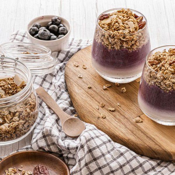 Blueberries coconut yogurt maple syrup granola breakfast parfait